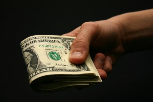 holding-money-1315939-639x426