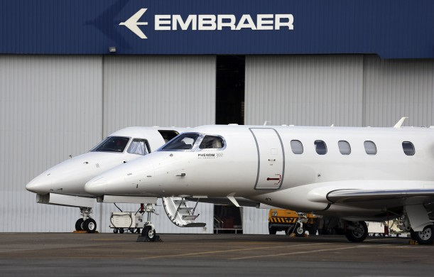 Private jets are seen at the Embraer headquarters in Sao Jose dos Campos, 100 km (62 miles) from Sao Paulo May 14, 2013. Brazil's barriers to international trade are limiting its growth potential and could hamper a huge infrastructure push at the center of President Dilma Rousseff's industrial agenda, the head of the U.S. Commerce Department said in a Tuesday interview. Acting Commerce Secretary Rebecca  Blank suggested the advantages given to Brazilian industries through import taxes and restrictions on government-led investments may even slow the development of globally competitive companies. REUTERS/Nacho Doce (BRAZIL - Tags: TRANSPORT BUSINESS)