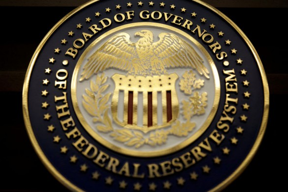 FILE PHOTO - The seal for the Board of Governors of the Federal Reserve System is on display in Washington, DC, U.S. on June 14, 2017.   REUTERS/Joshua Roberts/File Photo